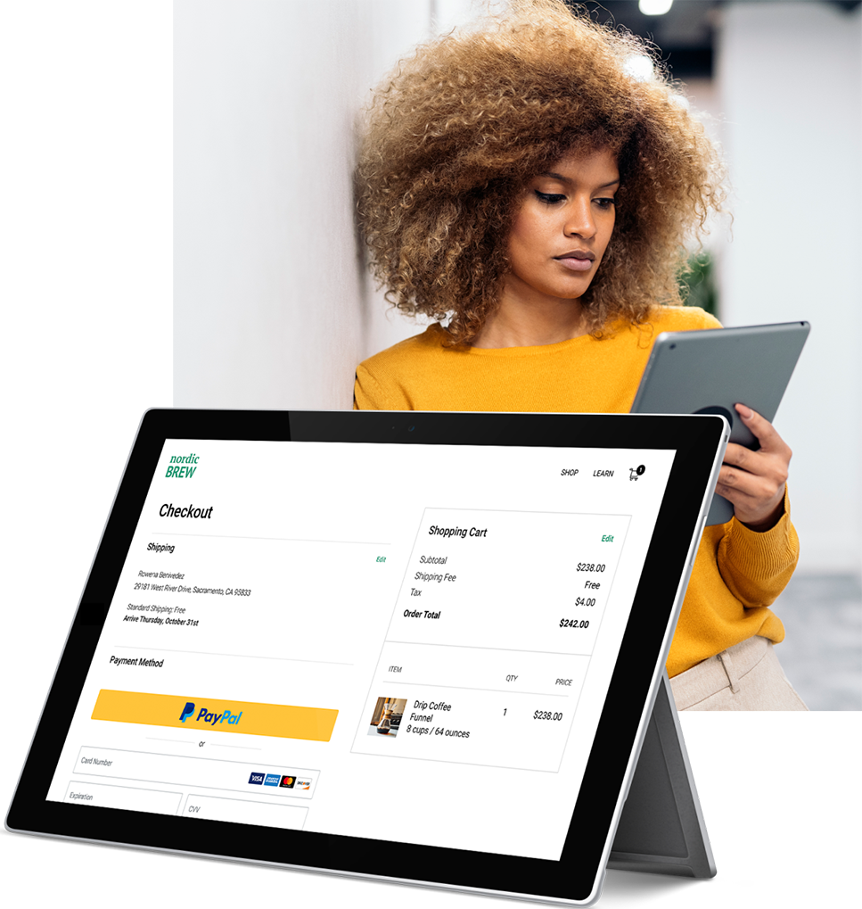 A woman is using her tablet to make a purchase online with PayPal