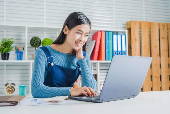 Woman using her laptop to shop online